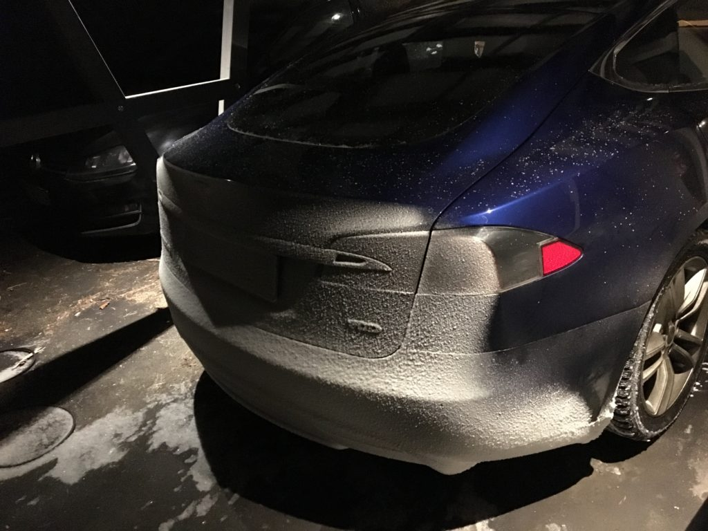 Snow collects on the back of the Model S