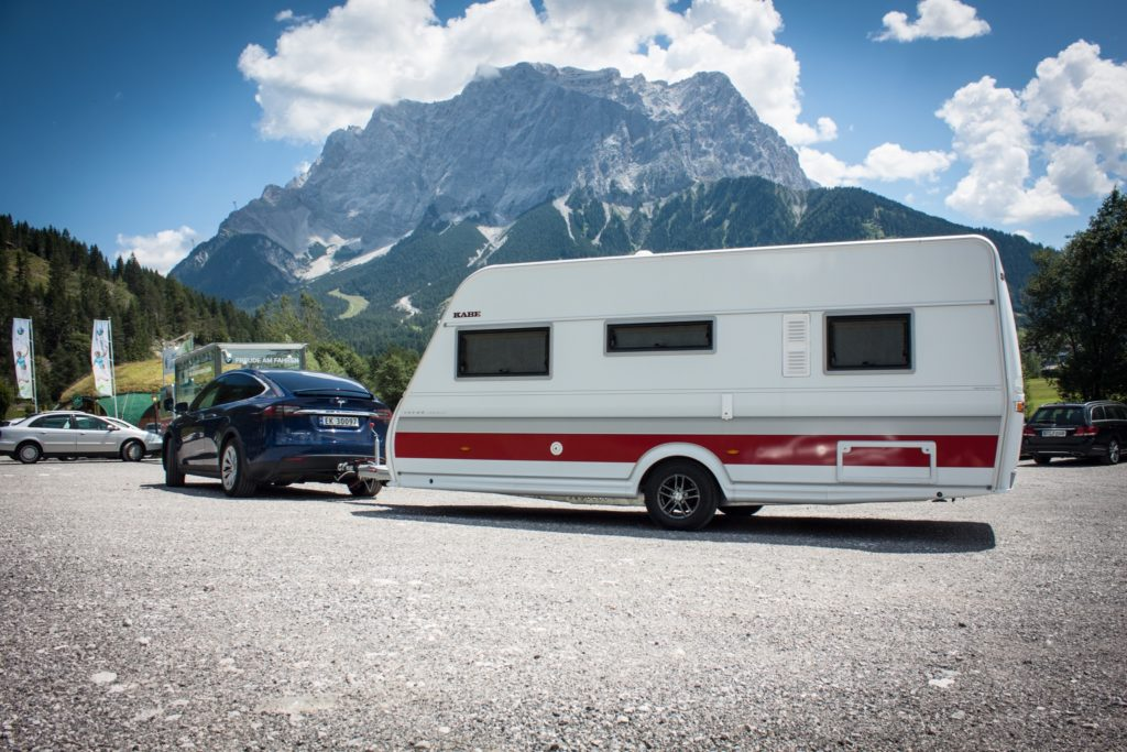 Tesla Model X with caravan trailer in the Alps