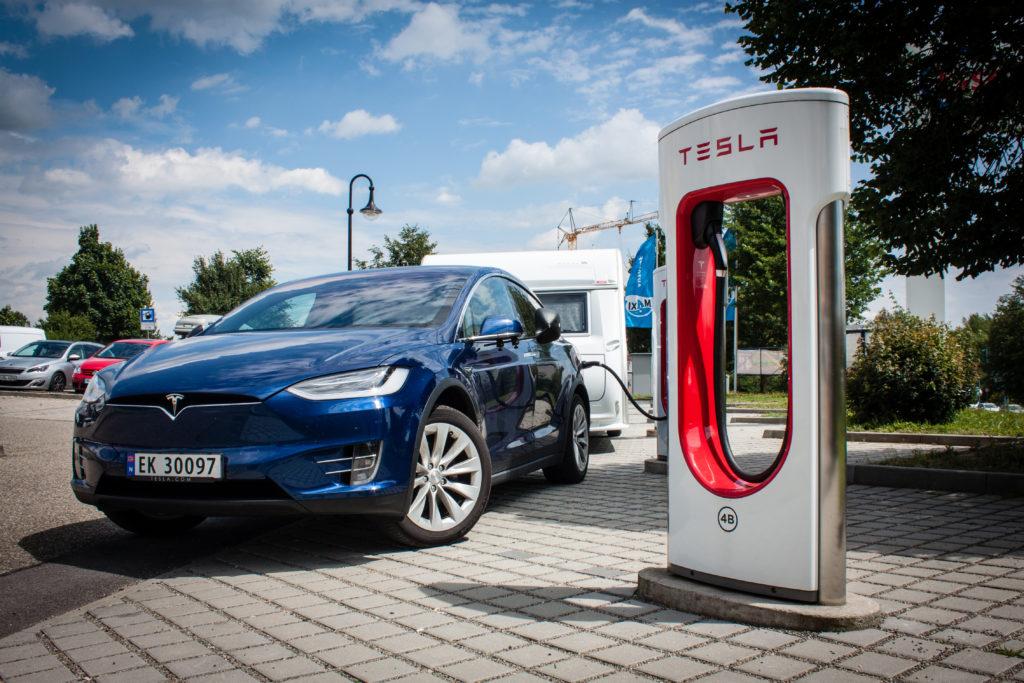 Tesla Model X charging with caravan